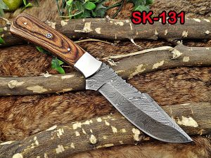 """11"""" Long hand forged Damascus steel full tang blade skinning Knife, 2 tone brown Dollar wood with Brass bolster scale, Cow Leather sheath"""