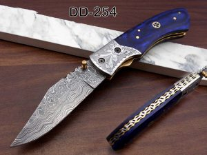 """8"""" long hand forged custom made Damascus steel pocket clip folding knife, Blue Colored wood scale with engraved steel Bolster, Cow hide leather sheath included"""