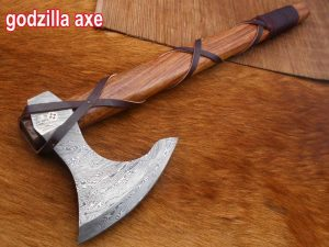 Hand forged Damascus steel Tomahawk Godzilla Axe, Hunting Axe, hiking battle axe Rose wood scale with leather wrap stripe